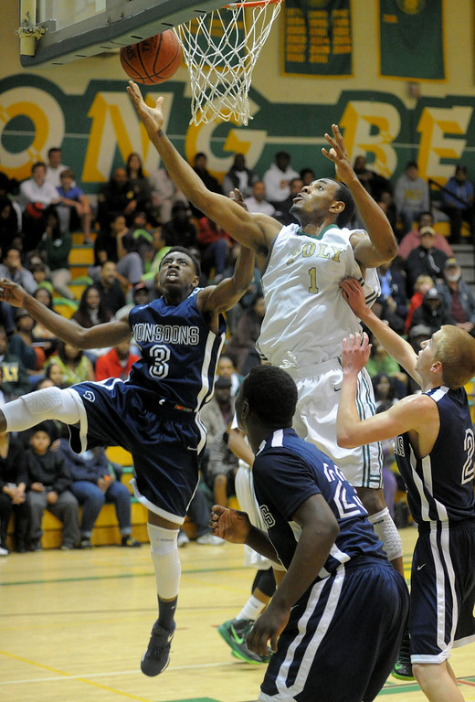 . 02-19-2012--(LANG Staff Photo by Sean Hiller)- Mayfair at Poly in the second round of the Division I-AA boys basketball playoffs Tuesday night. Mayfair\'s Michael Nwabuzor (3) blocks Poly\'s Roschon Prince.