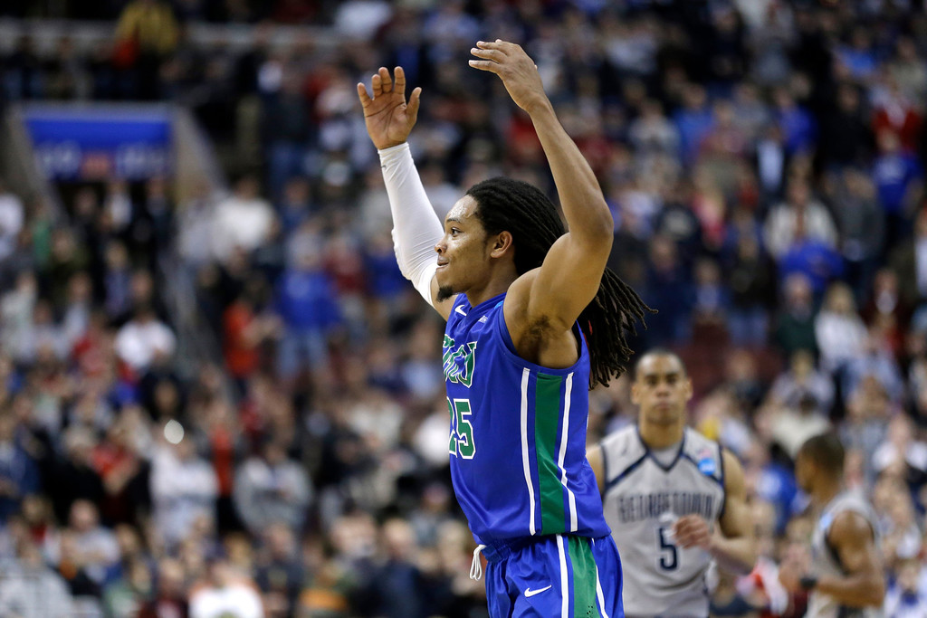 . Florida Gulf Coast\'s Sherwood Brown celebrates in the final minutes of a second-round game against Georgetown  in the NCAA college basketball tournament, Friday, March 22, 2013, in Philadelphia. Florida Gulf Coast won 78-68.(AP Photo/Matt Rourke)