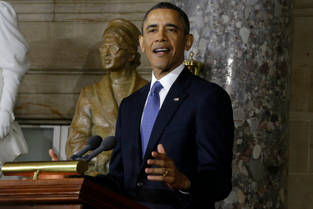 Description of . President Barack Obama speaks at the unveiling of a statue of Rosa Parks, left, Wednesday, Feb. 27, 2013, on Capitol Hill in Washington. (AP Photo/Charles Dharapak)