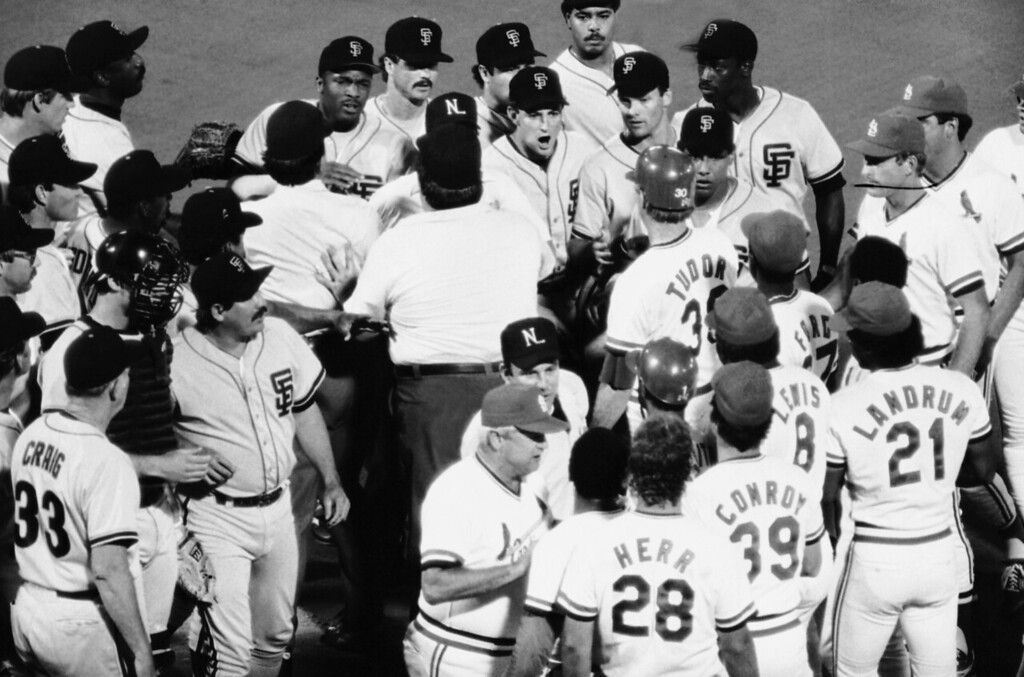 . National League umpires get in between San Francisco Giants, top, and St. Louis Cardinals players and coaches during a 7th inning bench-clearing brawl, Tuesday, July 23, 1986, St. Louis, Mo. Giants manager Roger Craig (33), Chris Brown and Frank Williams were ejected from the game for their part in the fight. The Cardinals won the game 10-7. The rest of the group is unidentified. (AP Photo)