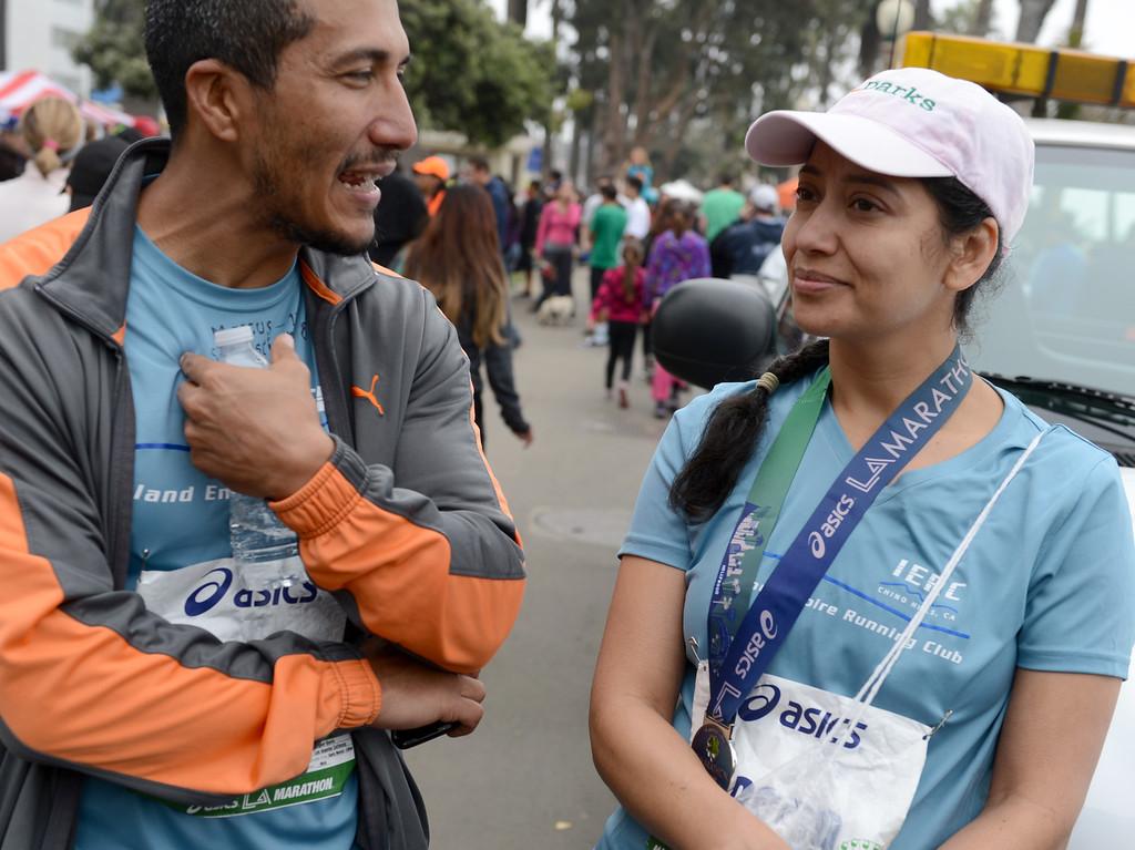 . Miguel Osorio, Los Angeles,  and Lupe Velasquez, Paramount, complete the L.A. Marathon in Santa Monica March 17, 2013. (Thomas R. Cordova/Staff Photographer)