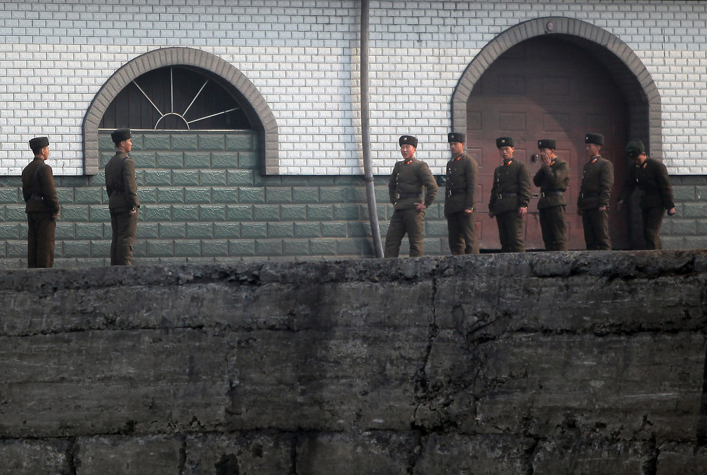 . North Korean soldiers assemble by the docks in the North Korean town of Sinuiju across from the Chinese city of Dandong on April 4, 2013. North Korea appears to have moved a medium range missile to its east coast, South Korean Defence Minister Kim Kwan-Jin said, prompting fears of a strike against South Korea or Japan.           CHINA OUT      AFP PHOTO        (Photo credit should read STR/AFP/Getty Images)