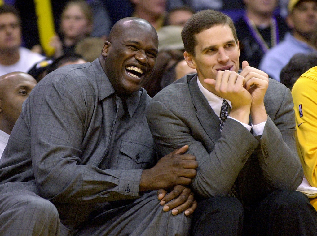 . Injured Los Angeles Lakers Shaquille O\'Neal, left, and Mark Madsen laugh as they joke around from the bench during the third quarter of the game against the Portland Trail Blazers Sunday, Nov. 3, 2002, in Los Angeles. The Lakers defeated the Trail Blazers, 98-95, in overtime. (AP Photo/Kevork Djansezian)
