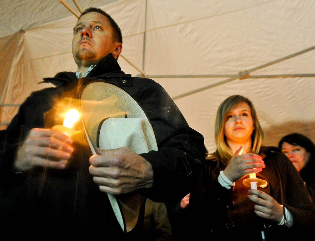 Description of . Despite heavy rainfall, more than 300 people attend a candlelight vigil in honor of fallen San Bernardino County Sheriff's Detective Jeremiah MacKay at the Yucaipa Community Center in Yucaipa, Calif. on Tuesday, Feb. 19, 2013. MacKay was killed by fugitive ex-cop Christopher Dorner on Feb. 12 during a fiery shootout, in which Dorner barricaded himself in a cabin near Big Bear and was later found dead of a gunshot wound that authorities believe was self-inflicted. (Rachel Luna / Staff Photographer)