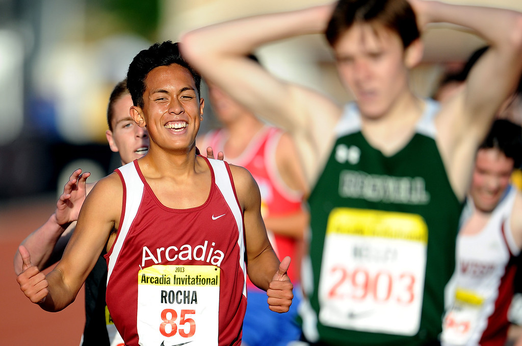 Description of . Arcadia's Phillip Rocha finished second in the one mile run seeded race during the Arcadia Invitational at Arcadia High School on Saturday, April 6, 2013 in Arcadia, Calif.  (Keith Birmingham Pasadena Star-News)