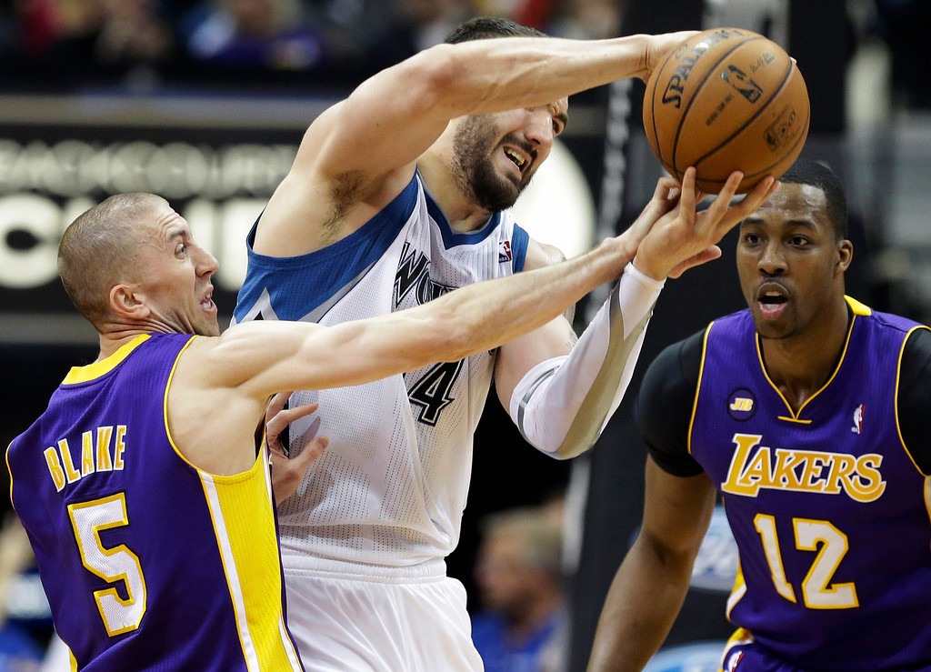 . Los Angeles Lakers\' Steve Blake, left, knocks the ball away from Minnesota Timberwolves\' Nikola Pekovic of Montenegro as Lakers\' Dwight Howard, right, watches in the second half of an NBA basketball game Wednesday, March 27, 2013 in Minneapolis. The Lakers won 120-117. (AP Photo/Jim Mone)