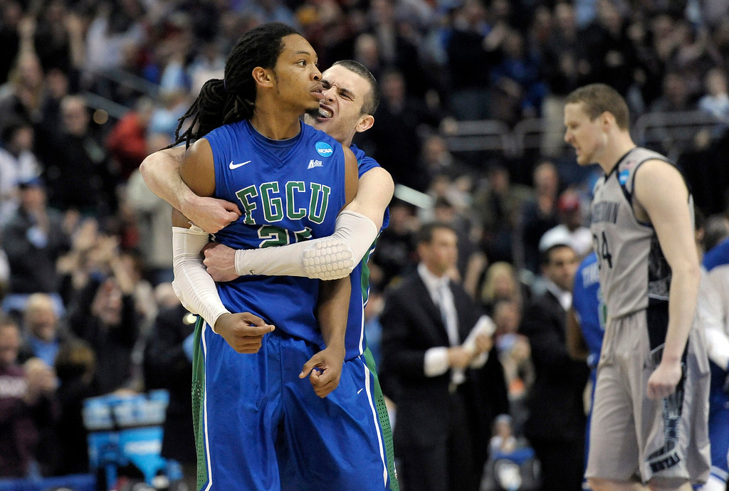 . Florida Gulf Coast\'s Sherwood Brown, left, and Brett Comer celebrate after Brown\'s basket during the second half of a second-round game against Georgetown in the NCAA college basketball tournament, Friday, March 22, 2013, in Philadelphia. (AP Photo/Michael Perez)
