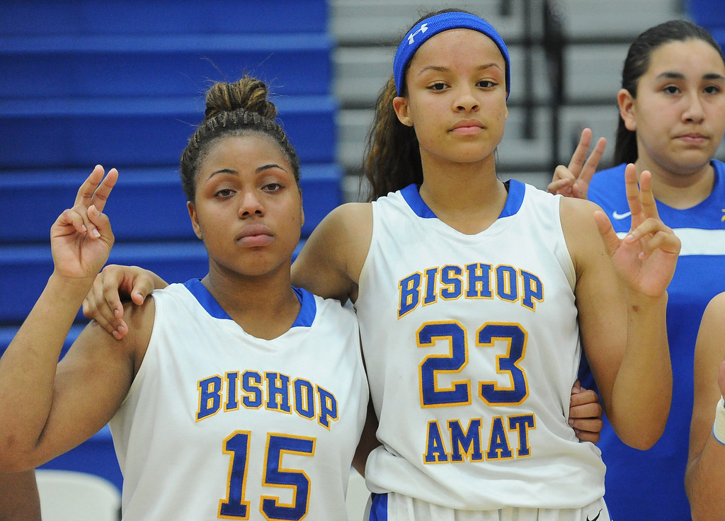 Description of . Bishop Amat's Leeah Powell (15) along with teammate Mauriana Clayton (23) sings the alma mater after Long Beach Poly won 52-34  during a CIF State Southern California Regional semifinal basketball game at Bishop Amat High School on Tuesday, March 12, 2013 in La Puente, Calif.  (Keith Birmingham Pasadena Star-News)