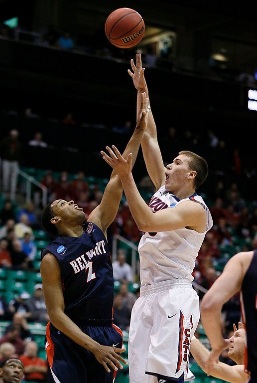 . Arizona\'s Kaleb Tarczewski, right, shoots over Belmont\'s Blake Jenkins during the first half of a second-round game in the NCAA college basketball tournament in Salt Lake City Thursday, March 21, 2013. (AP Photo/George Frey)