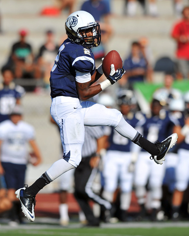 . St. John Bosco football takes on Chandler, Airzona as part of the Mission Viejo Classic in Mission Viejo, CA on Saturday, September 14, 2013. St. John Bosco won 52-31.  Bosco\'s Jaleel Wadood comes down with a reception. (Photo by Scott Varley, Press-Telegram)