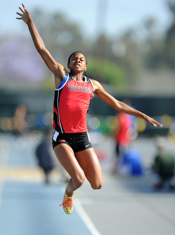 . Harvard Westlake\'s Courtney Corrin wins the long jump during the CIF-SS Masters Meet at Cerritos College on Friday, May 24, 2013 in Norwalk, Calif.  (Keith Birmingham Pasadena Star-News)