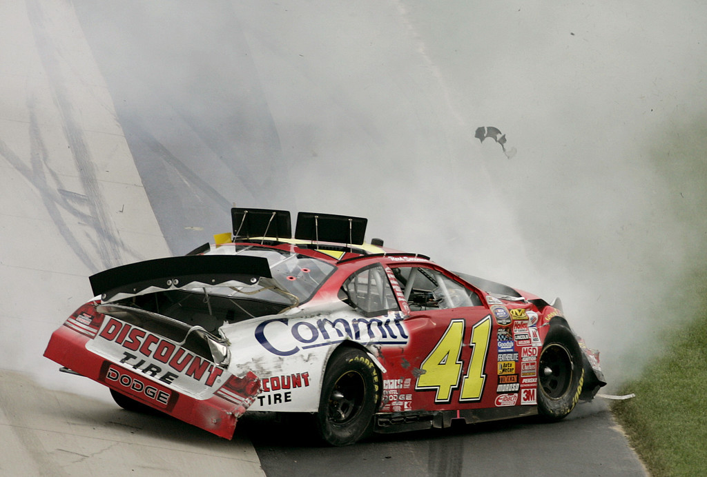 . Busch series  driver Reed Sorenson\'s car as he crashes while crossing the finish line of the Dover 200,  at the Dover Speedway in Dover, Del., Saturday, Sept. 23, 2006. Clint Bowyer won the race and Sorenson crashed as he crossed the finish line. (AP Photo/Chris Gardner)