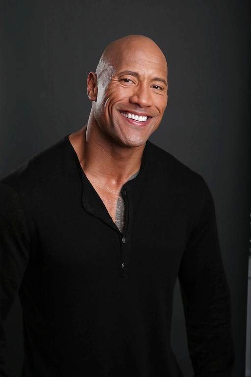 . In this Saturday, March 23, 2013 photo, Dwayne Johnson poses for a portrait at the Four Seasons in Los Angeles. The 40-year-old actor has become a savior of stale film series, injecting new life into �Fast Five,� �The Mummy Returns,� �Journey 2: The Mysterious Island� and now �G.I. Joe: Retaliation.� �We call him franchise Viagra,� said �Retaliation� director Jon M. Chu. �He comes in and he elevates everything, not just physically, but energy-wise... He was the only one in our minds that could reinvent G.I. Joe and carry the franchise forward.� (Photo by Eric Charbonneau/Invision/AP)