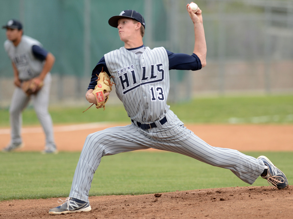 Description of . Chino Hills Bailey Falter pitches to Claremont who went on to win 6-3 April 25, 2013.  (Thomas R. Cordova/Staff Photographer)