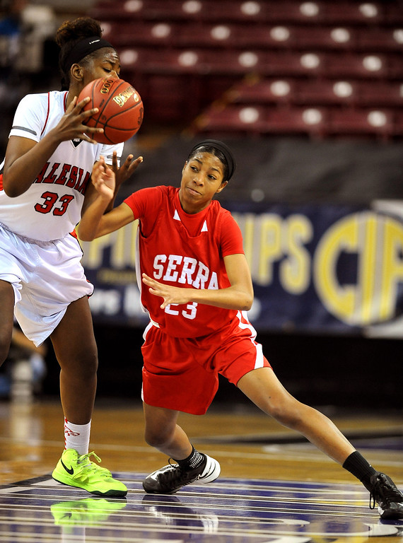. Serra High School\'s Caila Hailey defends Deja Stallworth of Salesian High School during the Division IV 2013 CIF State Basketball Championship at the Sleep Train Arena, in Sacramento, Ca March 23, 2013.  Serra won the game 62-60.(Andy Holzman/Los Angeles Daily News)