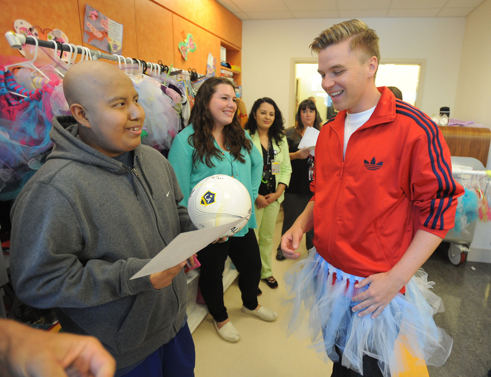 ". 04-18-2013-(LANG Staff Photo by Sean Hiller)-Toyota Grand Prix Celebrities visited Miller�s Children�s Hospital to visit the children they are raising money for through ""Racing for Kids.\""  Patient Adrian Benitez meet with celebrity driver Brett Davern."