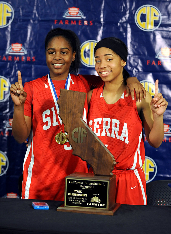 . Serra High School\'s Deandrea Toler and Siera Thompson pose for a photo after winning the Division IV 2013 CIF State Basketball Championship game at Sleep Train Arena, in Sacramento, Ca March 23, 2013.(Andy Holzman/Los Angeles Daily News)