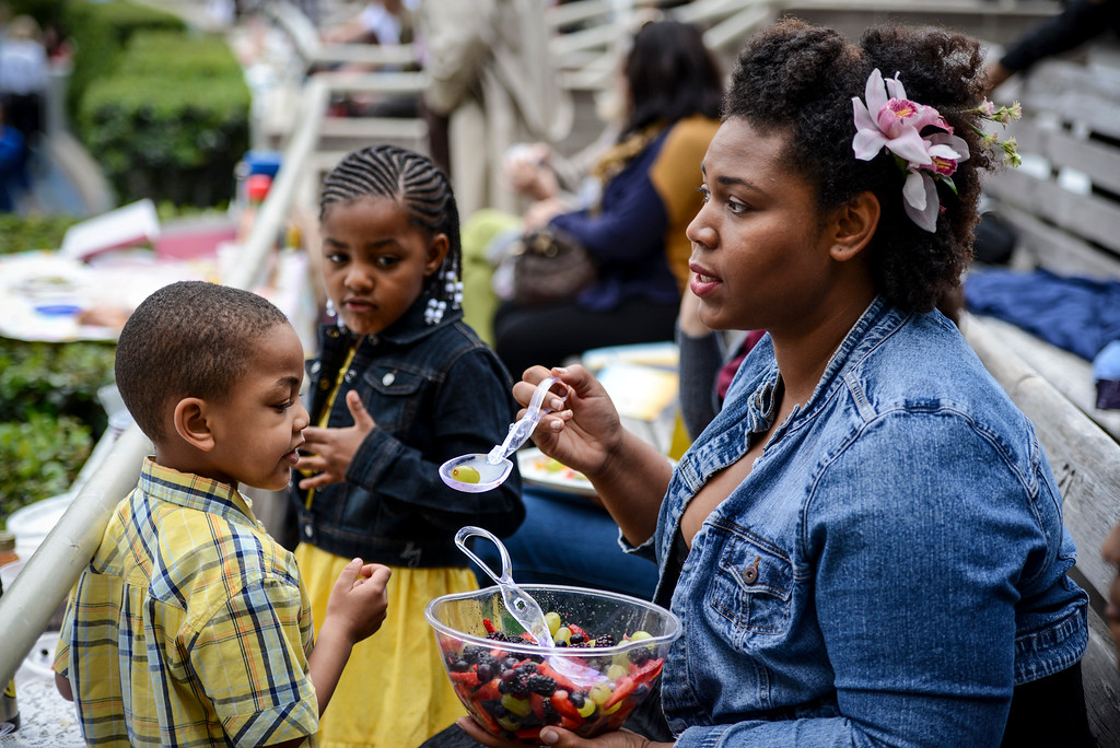 . Alexandria Parker of Pasadena feeds her niece and nephew before the start of the Hollywood Bowl for Easter Sunday service presented by Bel Air presbyterian and Christian Assembly Church of Eagle Rock.  Photo by David Crane/Los Angeles Daily News.