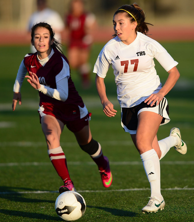 . Downey\'s Jocelyn Maldonado (18) chases down Torrance\'s Anika Rodriguez (77) in a CIF SS Division IV quarterfinal game Thursday at Zamperini Field. Downey won the game 3-1. 20130221 Photo by Steve McCrank / Staff Photographer