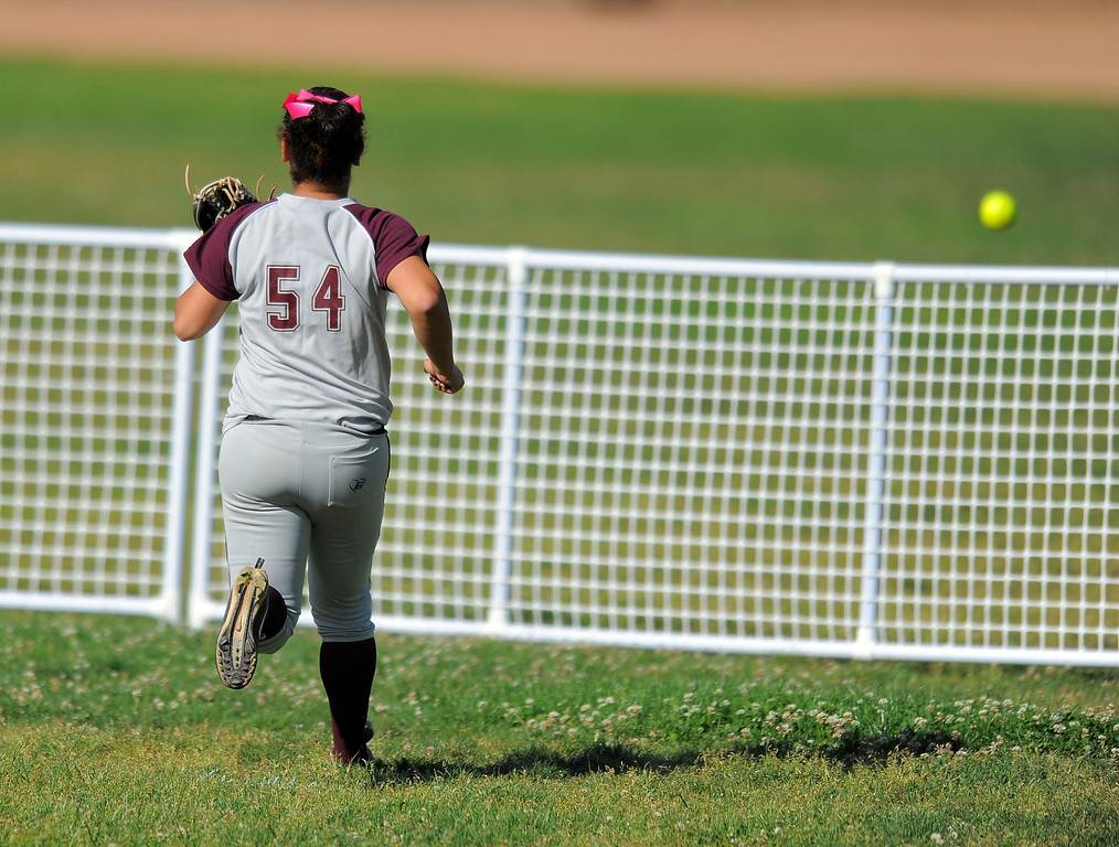 . TORRANCE - 04/03/2013  (Photo: Scott Varley, Los Angeles Newspaper Group)  South vs Torrance softball in a Pioneer League matchup. Torrance right fielder Reina Trejo watches a home run ball hit by South\'s Kristen Romero soar over the outfield fence.