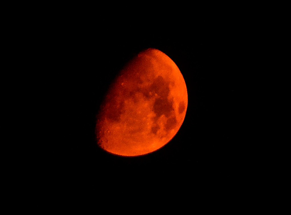 . A reddish moon is seen through the smoke in the west skies from the Mountain Fire near Idyllwild, California July 18, 2013. The blaze erupted on Monday afternoon about 100 miles (161 km) east of Los Angeles in the scenic but rugged San Jacinto Mountains that overlook Palm Springs, Rancho Mirage and several smaller desert towns.  Photo by Gene Blevins/LA Dailynews