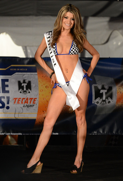 . Long Beach, Calif., -- 04-18-13-  Ashlee Wilson During the Tecate Light Miss Toyota Grand Prix of Long Beach Thursday night on Pine Avenue at the Tecate Light Thunder Thursday on Pine.   Stephen Carr/  Los Angeles Newspaper Group