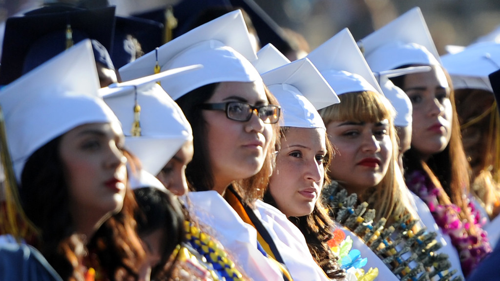 Description of . Students listen to speeches during the Montebello High School commencement at Montebello High School on Thursday, June 20, 2013 in Montebello, Calif.  (Keith Birmingham/Pasadena Star-News)