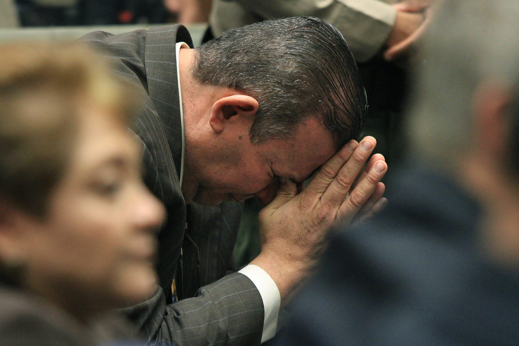 . Luis Artiga reacts after being acquitted on all charges in the Bell corruption trial on Wednesday, March 20, 2013, in Los Angeles.  Five former elected officials were convicted of multiple counts of misappropriation of public funds.  Former Mayor Oscar Hernandez and co-defendants George Cole, Teresa Jacobo, George Mirabal,  and Victor Belo were all convicted of multiple counts and acquitted of others.  The charges against them involved paying themselves inflated salaries of up to $100,000 a year in the city of 36,000 people, where one in four residents live below the poverty line.   (AP Photo/Los Angeles Times, Irfan Khan, Pool)