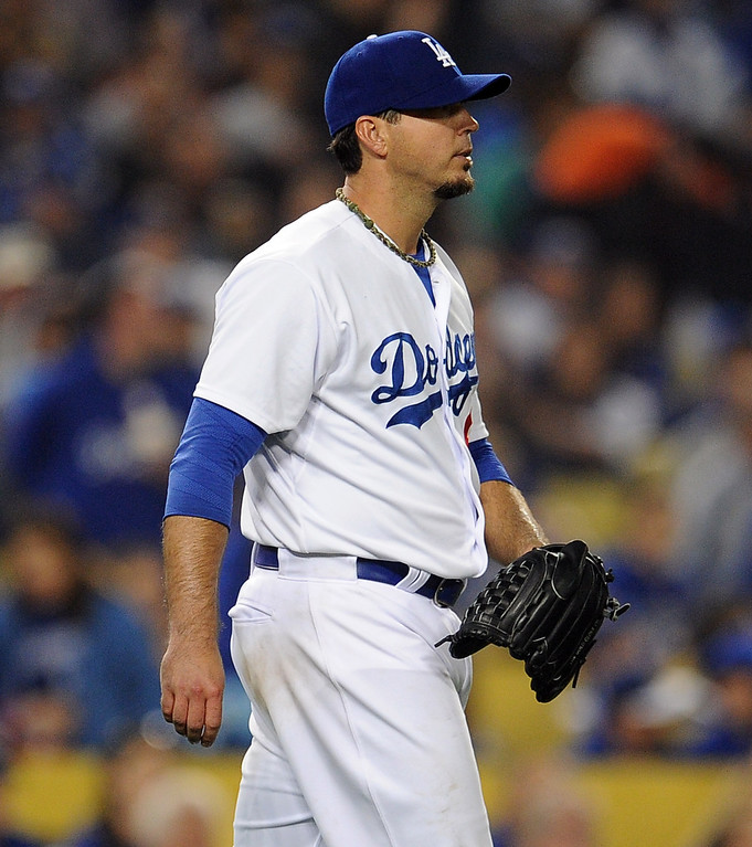 . Los Angeles Dodgers starting pitcher Josh Beckett looks toward the outfield after San Francisco Giants\' Hunter Pence (not pictured) hit a solo home run in the sixth inning of their baseball game on Wednesday, April 3, 2013 in Los Angeles. 