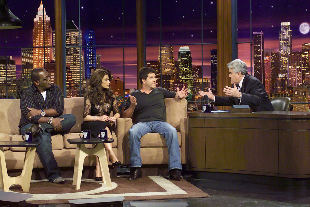 ". In this photo provided by NBC Universal, Randy Jackson, left, Paula Abdul, center left, and Simon Cowell, center right, all judges on the show ""American Idol\"" talk with Jay Leno during the taping of \""The Tonight Show with Jay Leno\"" in Burbank, Calif., Monday, Jan. 16, 2006. (AP Photo/Photo provided by NBC Universal) ** NO SALES **"