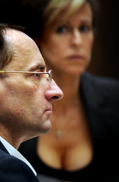 Description of . Christian Gerhartsreiter with one of his attorneys Daniell Menard listening to Dr. Frank Sheridan, coroner for San Bernardino County testify. The murder trial of Christian Gerhartsreiter, 52,  known as