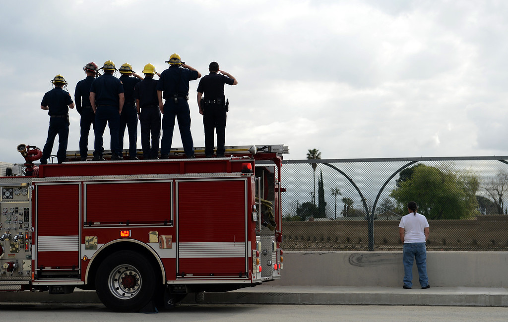 Description of . BN22-MACKAY-FUNERAL-03-JCM (Jennifer Cappuccio Maher/Staff Photographer) Members of the Rialto Police and Fire departments salute the funeral procession for San Bernardino County Sheriff's Detective Jeremiah MacKay as it heads westbound on the 210 freeway Thursday, February 21, 2013, in Rialto.