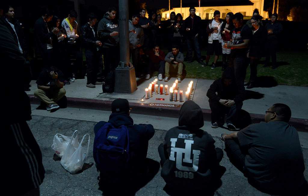 . Friends gather for a vigil to remember Ivan Arturo Aguilar Thursday, February 28, 2013, on Kellogg Drive at Cal Poly Pomona in Pomona. Aguilar, a 21-year-old communications student was struck and killed by a motorist on Kellogg Drive earlier in the day. Jennifer Cappuccio Maher/Staff Photographer