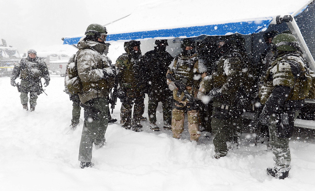 Description of . (Will Lester/Staff Photographer)  A San Bernardino County Sheriff SWAT team returns to the command post at Bear Mountain in Big Bear after searching for Christopher Jordan Dorner Friday February 8, 2013. Search conditions have been hampered as a heavy winter storm has hit the area.