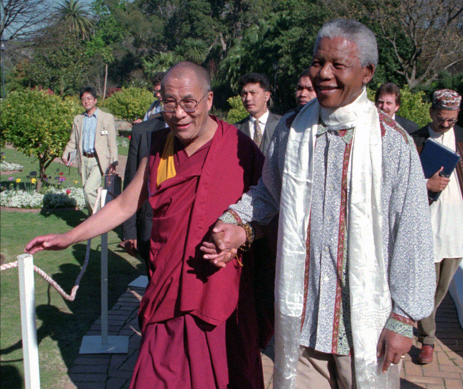 . In this Wednesday August 21, 1996, file photo Tibetan leader the Dalai Lama, left, meets with President Nelson Mandela, right, in Cape Town South Africa. South Africa said Monday, March 23, 2009,  it wanted to avoid being the source of bad publicity about trading partner China, and ended up itself the target of sharp criticism for barring the Dalai Lama from a peace conference in Johannesburg later this week. Friday\'s conference is now the target of a boycott by retired Cape Town Archbishop Desmond Tutu, former president F.W. de Klerk and members of the Nobel Committee who had been expected to be among Nobel laureates, Hollywood celebrities and other dignitaries discussing issues ranging from combatting racism to promoting sports to bring people and nations together. (AP Photo/Sasa Kralj, File)
