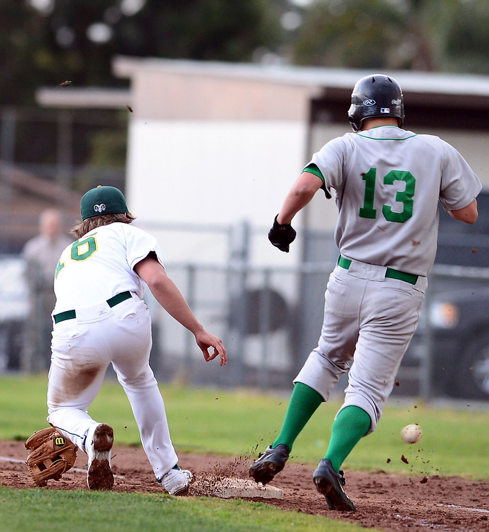 . Temple City\'s pitcher Nick Starling (16) tries to out Monrovia\'s Erik Cox (13) at first during the Arcadia Elks Tournament Thursday, March 7, 2013 at Temple City High School.  (SGVN/Staff Photo by Sarah Reingewirtz)