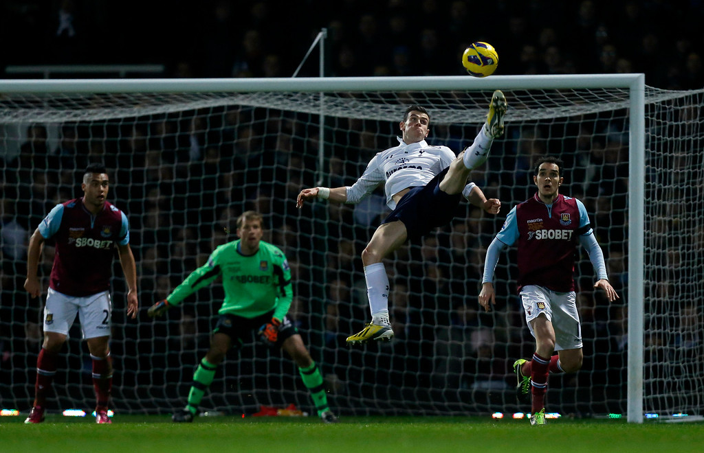 . Tottenham Hotspur\'s Gareth Bale, second right, attempts an overhead kick during the English Premier League soccer match between West Ham and Tottenham Hotspur at Upton Park stadium in London, Monday, Feb. 25, 2013.  (AP Photo/Matt Dunham)