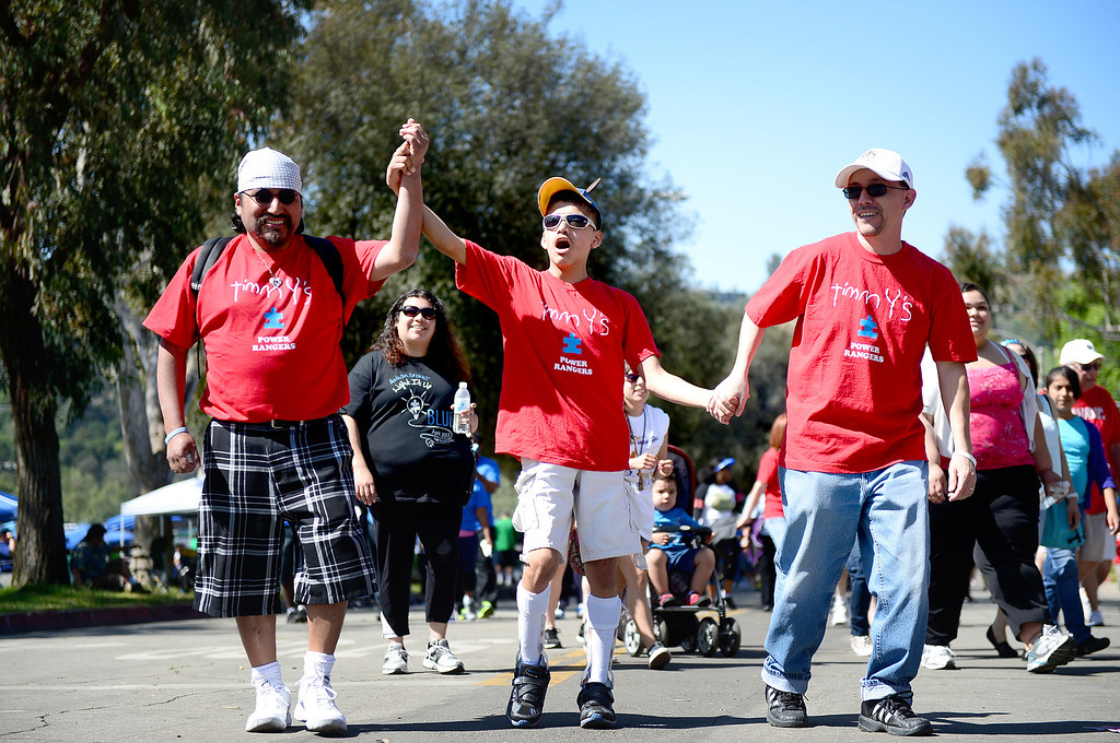 Description of . Timmy's Team walks in the 11th annual Los Angeles Walk Now for Autism Speaks at the Rose Bowl in Pasadena Saturday April 20, 2013. (SGVN/Staff Photo by Sarah Reingewirtz)