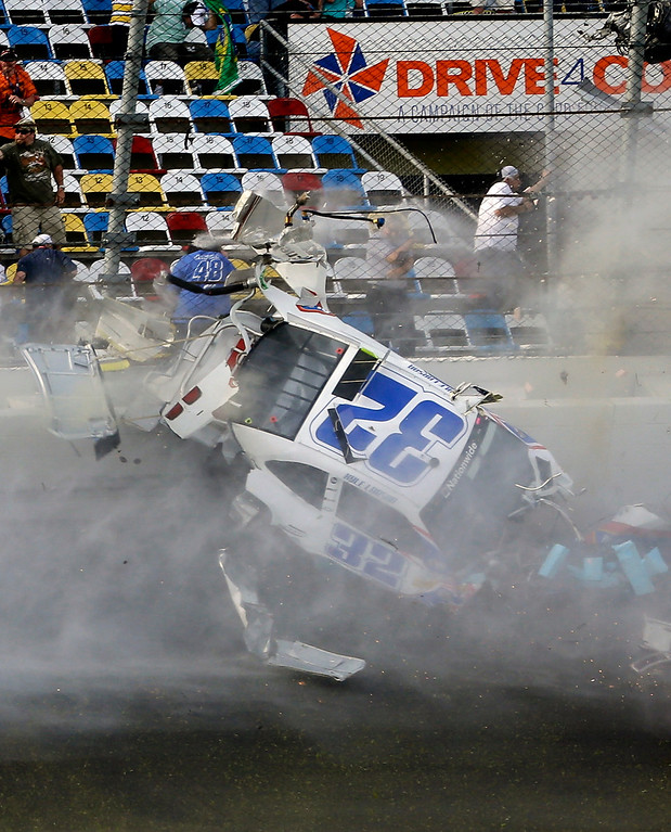 . Kyle Larson crashes into the catch fence in a multi-car crash on th efinal lap of the NASCAR Nationwide Series auto race at Daytona International Speedway, Saturday, Feb. 23, 2013, in Daytona Beach, Fla. (AP Photo/John Raoux)