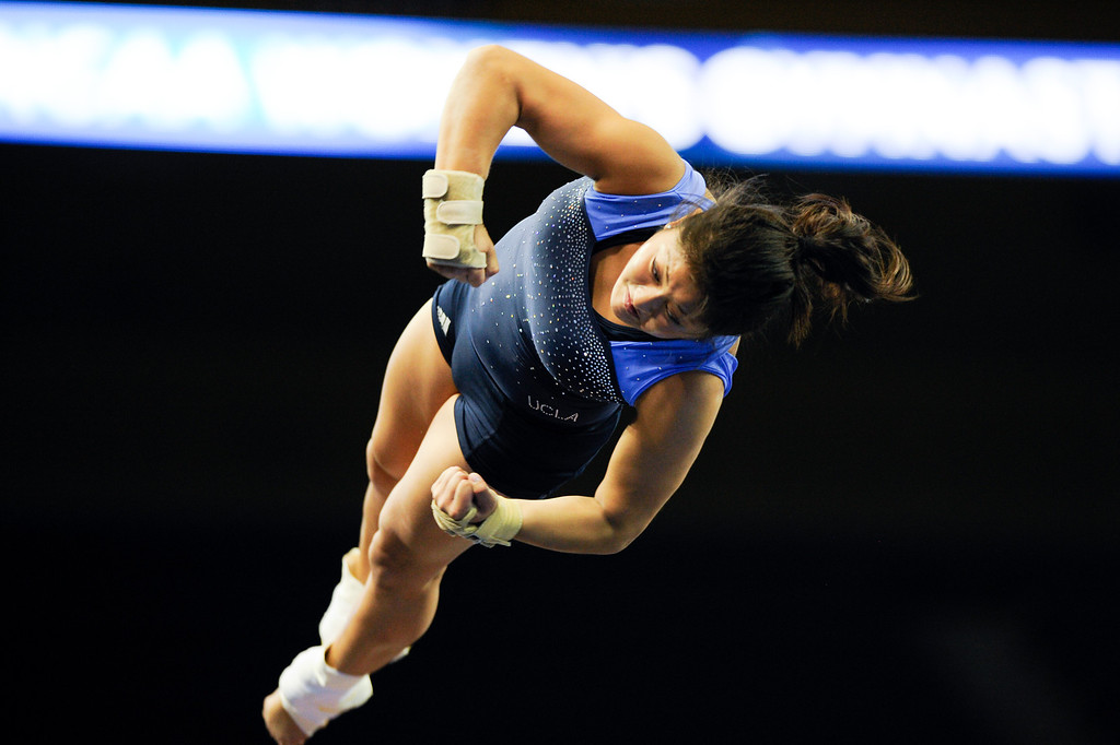 . UCLA\'s Sydney Sawa practices on the vault. (Michael Owen Baker/Staff Photographer)