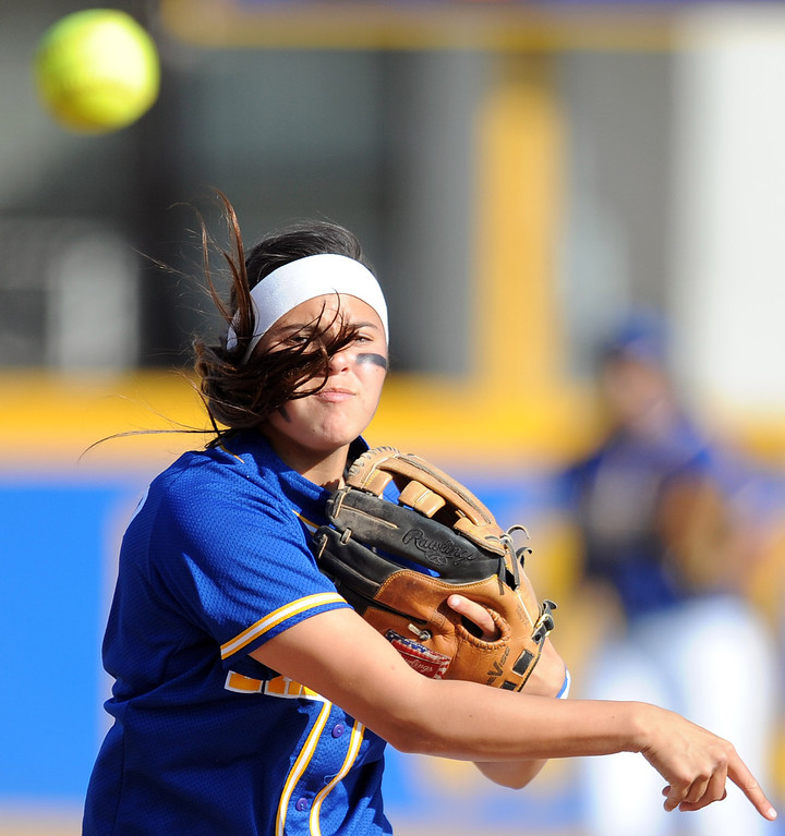Description of . Bishop Amat shortstop Victoria Saucedo throws out Santiago's Kaylin Crumpton (not pictured) in the fifth inning of a prep softball game at Bishop Amat High School on Wednesday, March 27, 2013 in La Puente, Calif. Bishop Amat won 5-3.  (Keith Birmingham Pasadena Star-News)