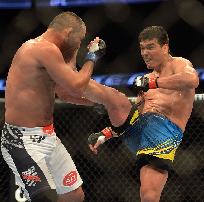 . Lyoto Machida lands a front kick to the face of Dan Henderson during their UFC 157 match at the Honda Center in Anaheim Saturday, February  23, 2013. Machida won the fight via judges decision. (Hans Gutknecht/Staff Photographer)