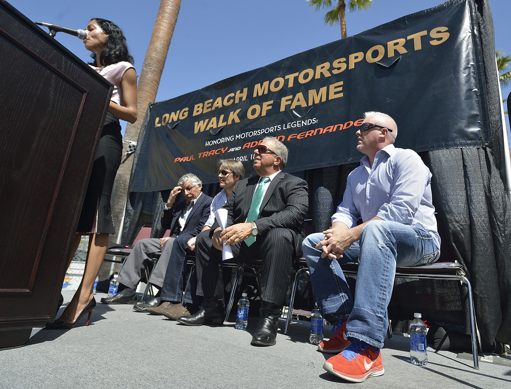 . LONG BEACH, CALIF. USA --  Jim Michaelian, President & CEO of the Long Beach Grand Prix, left, Adrian Fernandez, Mayor Bob Foster, and Paul Tracy, right, listen as Council member Suja Lowenthal opens the Long Beach (Calif.) Motorsports Grand Prix Walk of Fame induction ceremony on April 18, 2013. This year include Paul Tracy of Canada and Adrian Fernandez of Mexico. The annual Long Beach Motorsports Walk of Fame induction ceremony occurs in April of each year the Thursday before Toyota Grand Prix of Long Beach race weekend. Photo by Jeff Gritchen / Los Angeles Newspaper Group