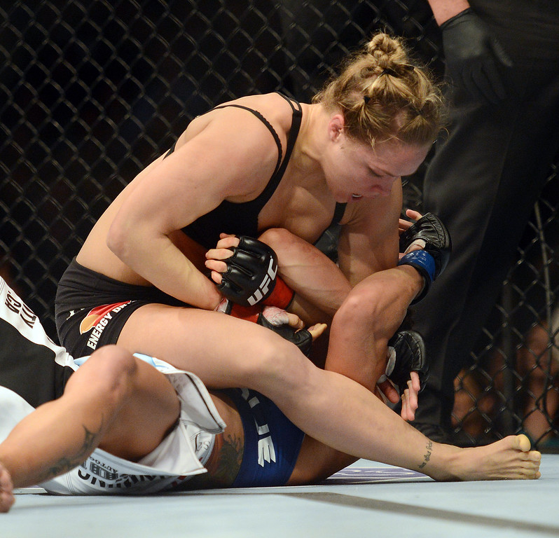 . UFC women�s bantamweight champion Ronda Rousey battles Liz Carmouche during their UFC 157 match at the Honda Center in Anaheim, CA Saturday, February 23, 2013. Rousey beat Carmouche via first round submission. (Hans Gutknecht/Staff Photographer)