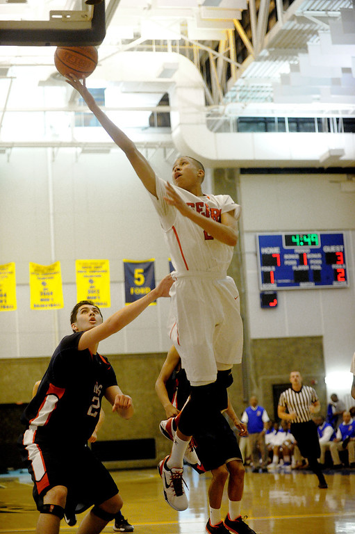 . 03-12-2013--(LANG Staff Photo by Sean Hiller)-Serra\'s Ron Freeman goes to the basket against Pacific Hills\' Adam Palx in Tuesday\'s boys basketball IV Southern California Regional semifinal at L.A. Southwest College.