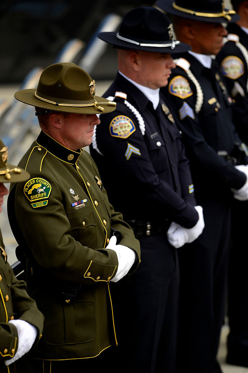 Description of . A Placer County Sheriff Deputy stands at attention during  memorial services for San Bernardino County Sheriff Deputy Jeremiah MacKay at the San Manuel Amphitheater in Devore February 21, 2013.  GABRIEL LUIS ACOSTA/STAFF PHOTOGRAPHER.