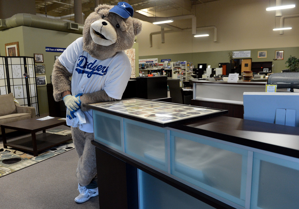 ". Mark Monninger as ""The Bear,\"" from Monday\'s Dodgers game, at his business Hoopers Office Furniture in Rancho Cucamonga, CA Tuesday, October 15, 2013. (Jennifer Cappuccio Maher/Inland Valley Daily Bulletin)"