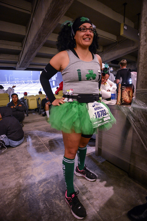 . Norma Urie of Santa Fe Springs prepares for the LA Marathon Sunday at Dodger Stadium. Photo by David Crane/Staff Photographer