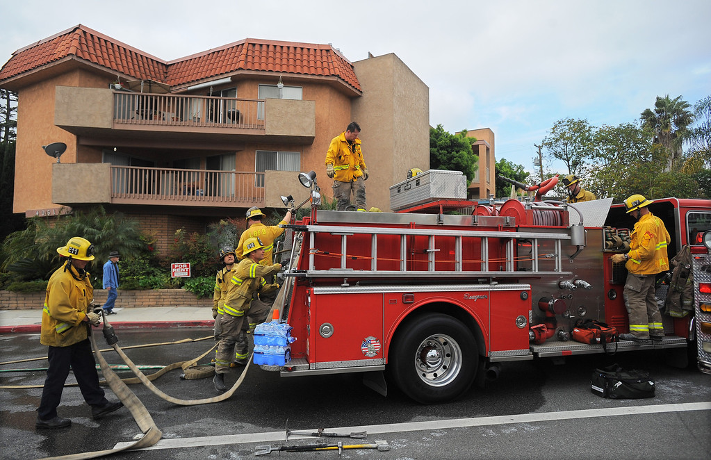 . LONG BEACH - 03/27/2013  (Photo: Scott Varley, Los Angeles Newspaper Group)  Long Beach firefighters quickly put out a 3rd floor apartment fire Wednesday morning at 4051 Elm Ave. The fire, possibly electrical, was confined to one unit after it went into the attic and between walls. It was reported at 9:11 a.m. and was put out within 25 minutes by firefighters from five engines and one truck that responded, according to Battalion Chief Jeff Ohs.