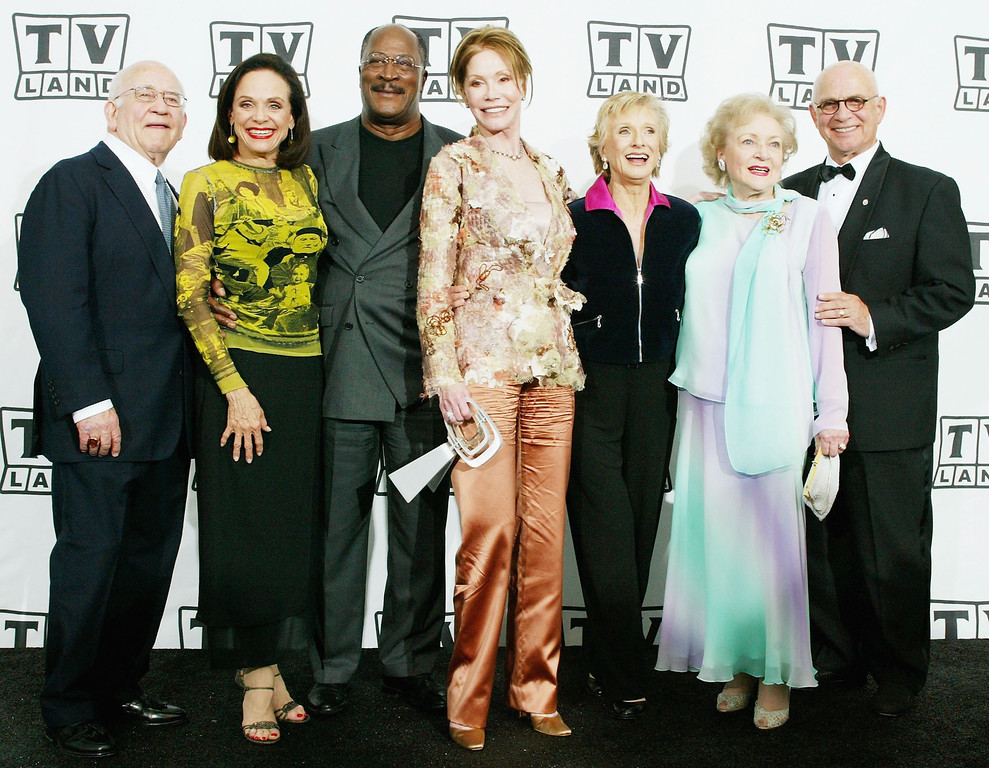 . HOLLYWOOD, CA - MARCH 7:  Actor Ed Asner, actress Valerie Harper, actor John Amos, actresses Mary Tyler Moore, Cloris Leachman and Betty White and actor Gavin MacLeod pose backstage at the 2nd Annual TV Land Awards held at The Hollywood Palladium, March 7, 2004 in Hollywood, California.  (Photo by Frederick M. Brown/Getty Images)
